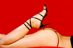 Sexy body. Sexy woman in red thong on red background Royalty Free Stock Photo
