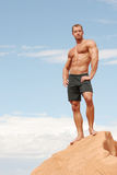 Sexy body builder man. Muscular body builder man in black shorts Royalty Free Stock Images
