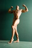 Sexy body builder in nude Stock Photography