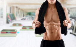 Sexy body of muscular man in gym Stock Photography