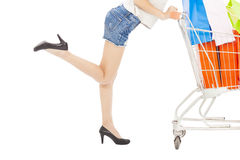 Sexy body of woman pushing a shopping cart Royalty Free Stock Photos