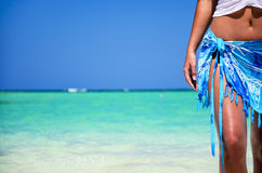 Sexy body of woman on tropical beach. Sexy body of relaxing woman on exotic tropical beach Royalty Free Stock Photo