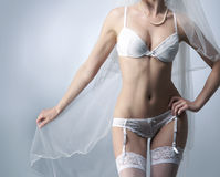 Sexy body of a woman in white erotic lingerie Royalty Free Stock Images