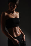 Sexy body of young attractive sporty lady Stock Photography