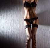 Sexy body of a young woman in black lingerie Royalty Free Stock Photography