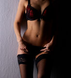 Sexy body of a young woman in dark erotic lingerie Stock Photo