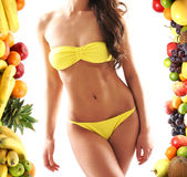 Sexy body of a young woman with fresh fruits Royalty Free Stock Photo