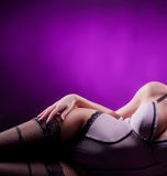 Sexy body of a young woman laying in lingerie Royalty Free Stock Photos