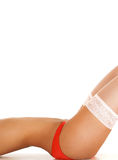 Sexy body of a young woman laying in white panties Royalty Free Stock Photos