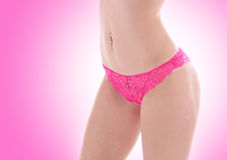 Sexy body of a young woman in pink panties Stock Photos