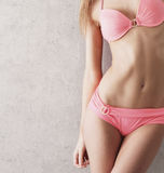 Sexy body of a young woman in a pink swimsuit Royalty Free Stock Image