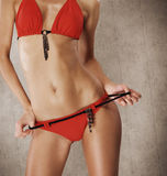Sexy body of a young woman in a red swimsuit Royalty Free Stock Images