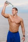 Sexy bodybuilder on the beach Stock Image