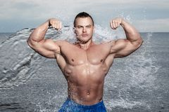 Sexy bodybuilder on the beach Stock Photo