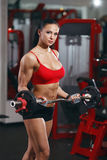 bodybuilder girl with barbell in the gym royalty free stock photography