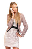 Sexy boss making a call on white background Royalty Free Stock Image