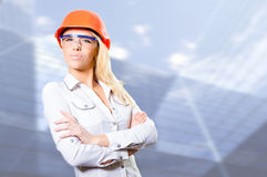 Sexy bossy blonde girl in helmet with folded hands Stock Images