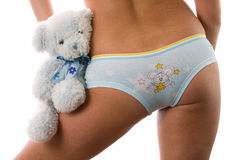 Sexy bottom in underwear with soft toy. Royalty Free Stock Image