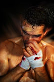 Boxer Moving. Gritty portrait of a young, bloody boxer stock photos