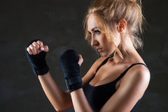 Sexy boxer woman making kick with boxing bandage Stock Images