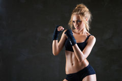 Sexy boxer woman making kick with boxing bandage Royalty Free Stock Photo