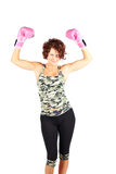 Sexy Boxing. Pretty woman in work out clothes and boxing gloves Royalty Free Stock Photo