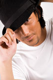 Boy with a hat. Indonesian young man with a look royalty free stock image