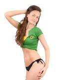Sexy Brazilian girl. Attractive girl in bikini with Brazilian flag on her green t-shirt. Stock Photos