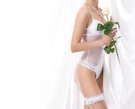 A sexy bride in erotic lingerie over white background Royalty Free Stock Photography