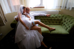Sexy bride with groom on the sofa Stock Photo