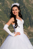 Sexy bride in long white dress in the mountains Royalty Free Stock Image