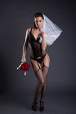 Sexy bride posing in black lingerie and veil Stock Photos