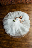 Sexy bride in the studio is lying on the wooden floor Stock Images