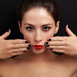 Sexy bright make-up woman with red lipstick and black nails polish Stock Photos