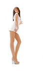 Brunette. A brunette with long legs in casual clothing royalty free stock image