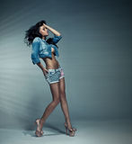 Sexy brunette. Attractive brunette wearing fashion clothes Stock Images