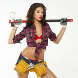 Sexy brunette with an ax in his hand Royalty Free Stock Photos