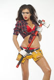 Sexy brunette with an ax in his hand Royalty Free Stock Photo