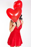 Sexy brunette with balloons heart Royalty Free Stock Images