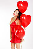 Sexy brunette with balloons heart Royalty Free Stock Photo