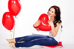 Sexy brunette with balloons heart in studio Royalty Free Stock Image