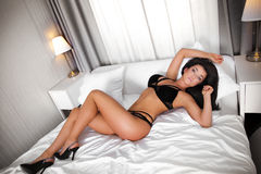 Sexy brunette in bed. Royalty Free Stock Images