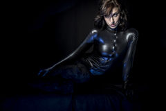 Sexy brunette in black latex costume, Fashion shot of a woman in Royalty Free Stock Photo