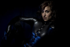 Sexy brunette in black latex costume, Fashion shot of a woman in Stock Photography