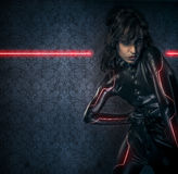 Sexy brunette in black latex costume , science fiction scene, fa Royalty Free Stock Image