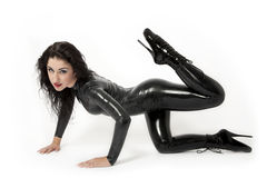 Sexy brunette in black latex. High heels Royalty Free Stock Images
