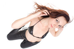 Sexy brunette in black leather pants Stock Photos