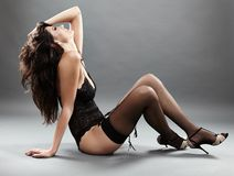 Sexy brunette in black lingerie Royalty Free Stock Image