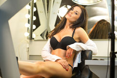 Sexy brunette in black lingerie and white shirt sitting on the v Royalty Free Stock Image