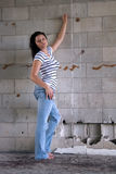 Sexy Brunette at a Block Wall (3) Royalty Free Stock Photos